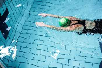 Woman Swimming laps in Pool