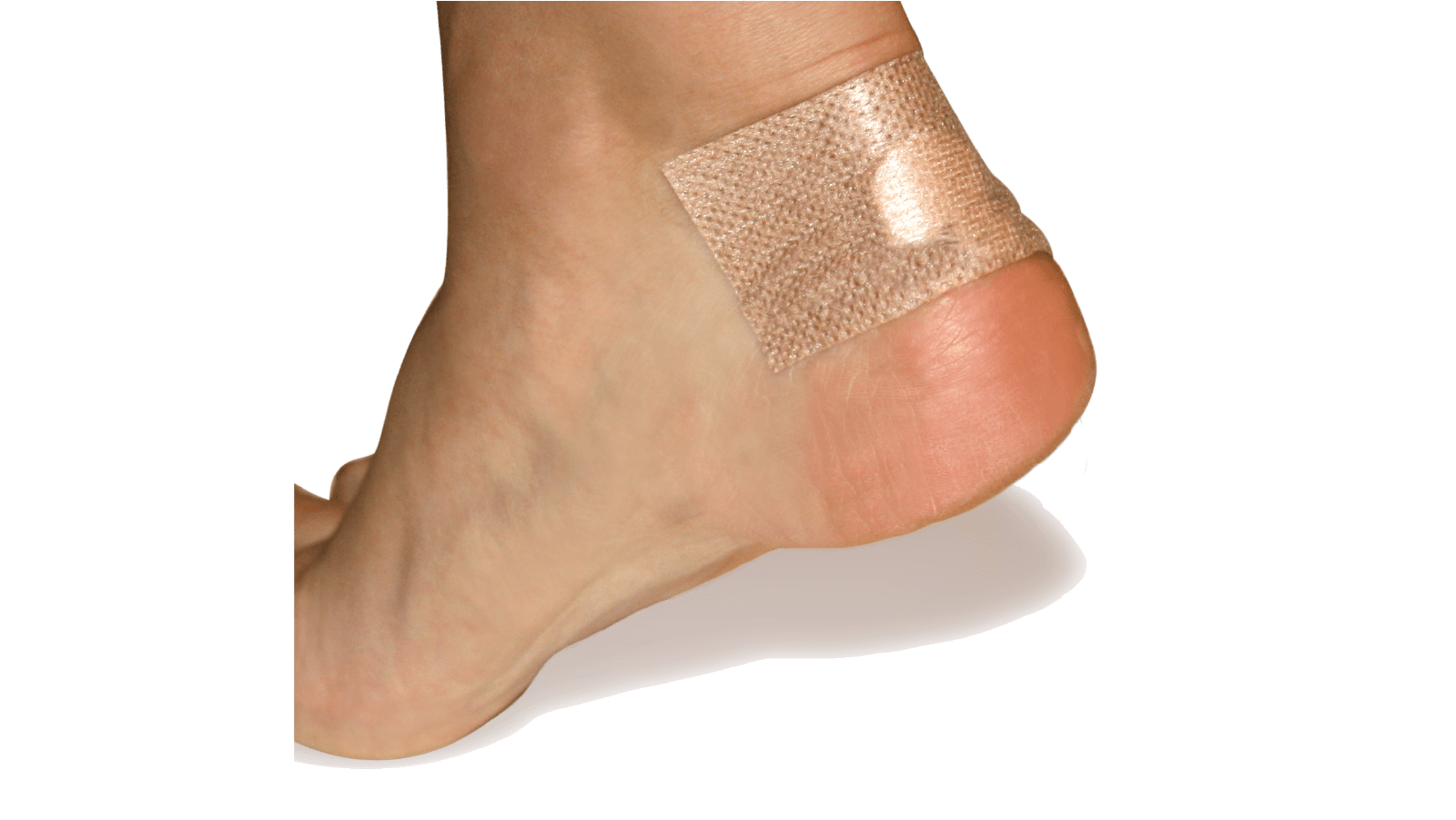 Adhesive knit strip from the Spenco 2nd skin blister kit placed on a heel