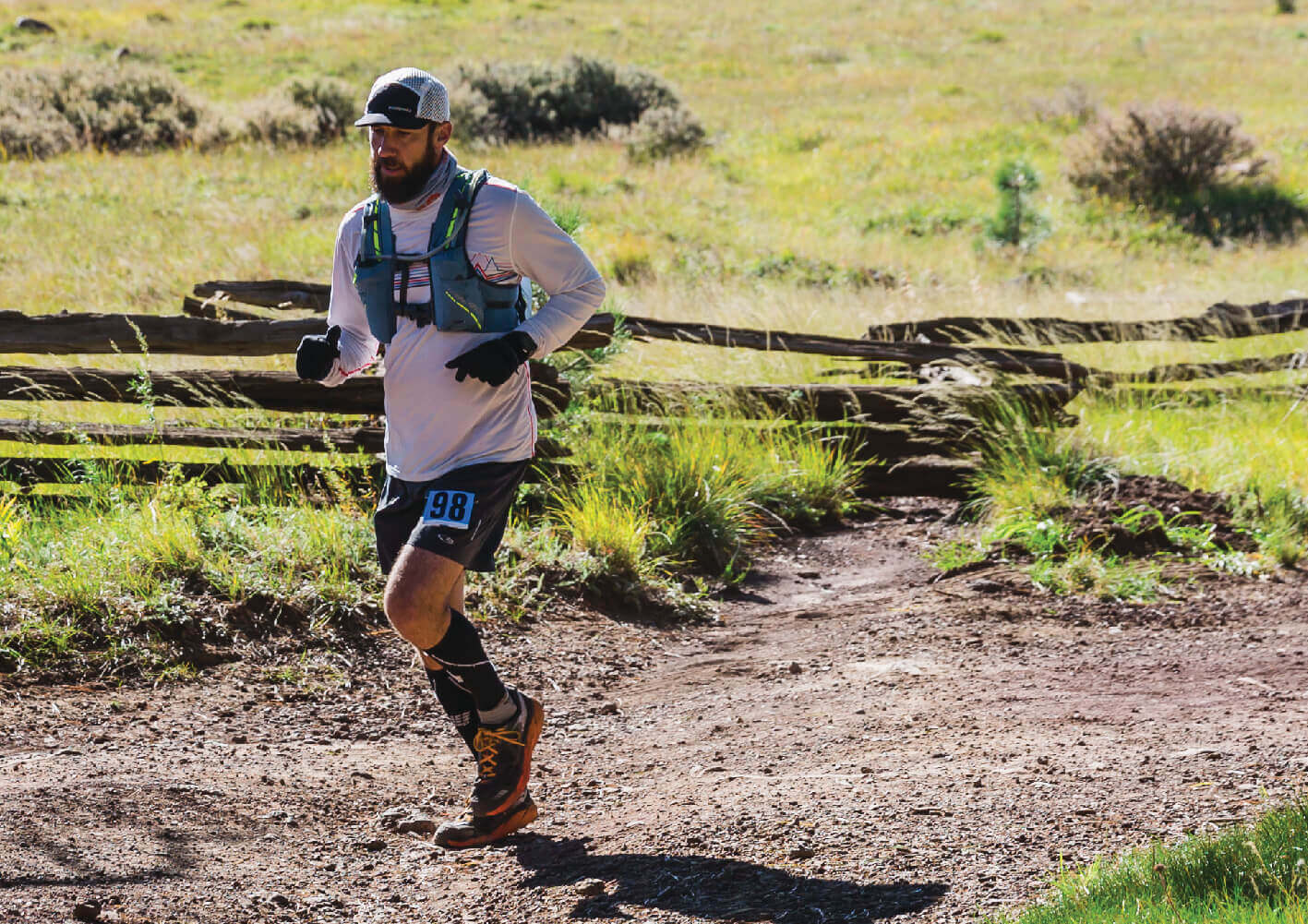 Spenco brand ambassador, Devon Ruse running mid-race on a natural trail