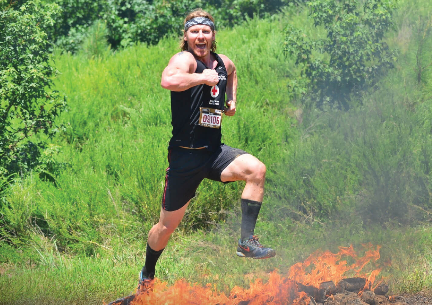 Spenco​ ​brand​ ​ambassador,​ ​Brian​ ​Boyle​ ​flexing​ ​his​ ​muscles​ ​after​ ​a​ ​race