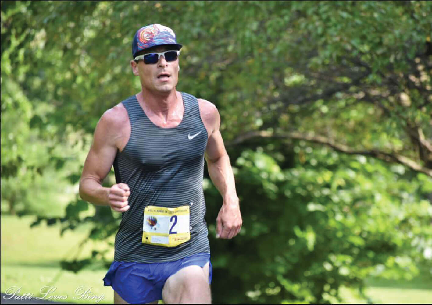 Spenco​ ​brand​ ​ambassador,​ ​Michael​ ​Kent​ ​running​ ​mid-race​ ​in​ ​a​ ​city